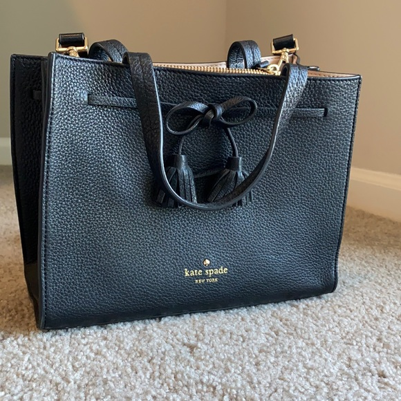 Kate Spade Black satchel with a bow. Mid-size and barely used
